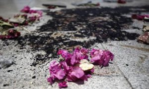 blood and flowers at massacre site
