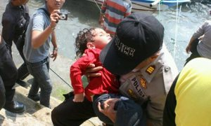 rescuer with exhausted child