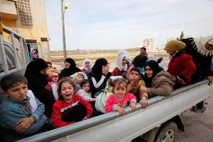 Civilians flee from fighting after Syrian army tanks enter Idlib