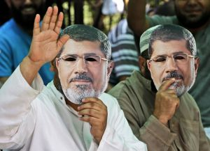 protesters with Morsi masks