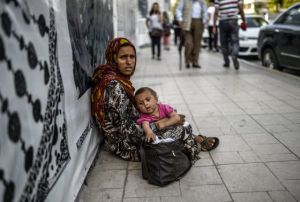 refugee mother in Istambul (The poor are always here to be helped)