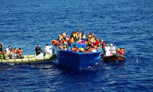 The Italian navy helping refugees in the Mediterranean sea.