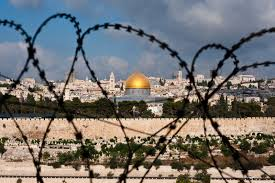 holy city through barbed wire