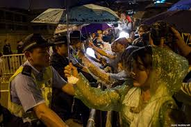 protesters shelter police from rain