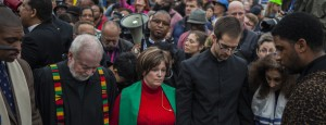 People pray in advance of Grand Jury decision on black man, Michael Brown's death