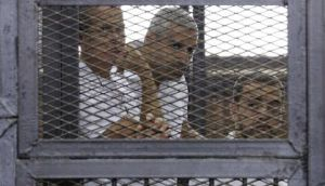 Al Jazeera journalists await liberation from Egyptian jail