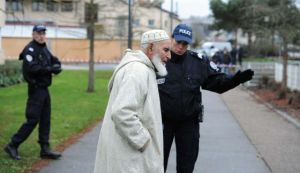 Police protect elderly worshiper