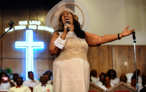 Bringing a psalm: Aretha Franklin sings during a memorial service for her father and brother, Rev. C.L. and Rev. Cecil Franklin, at New Bethel Baptist Church, where they were ministers, in Detroit, Mich., on Sunday, June 7, 2015. (Elizabeth Conley/The Detroit News via AP)